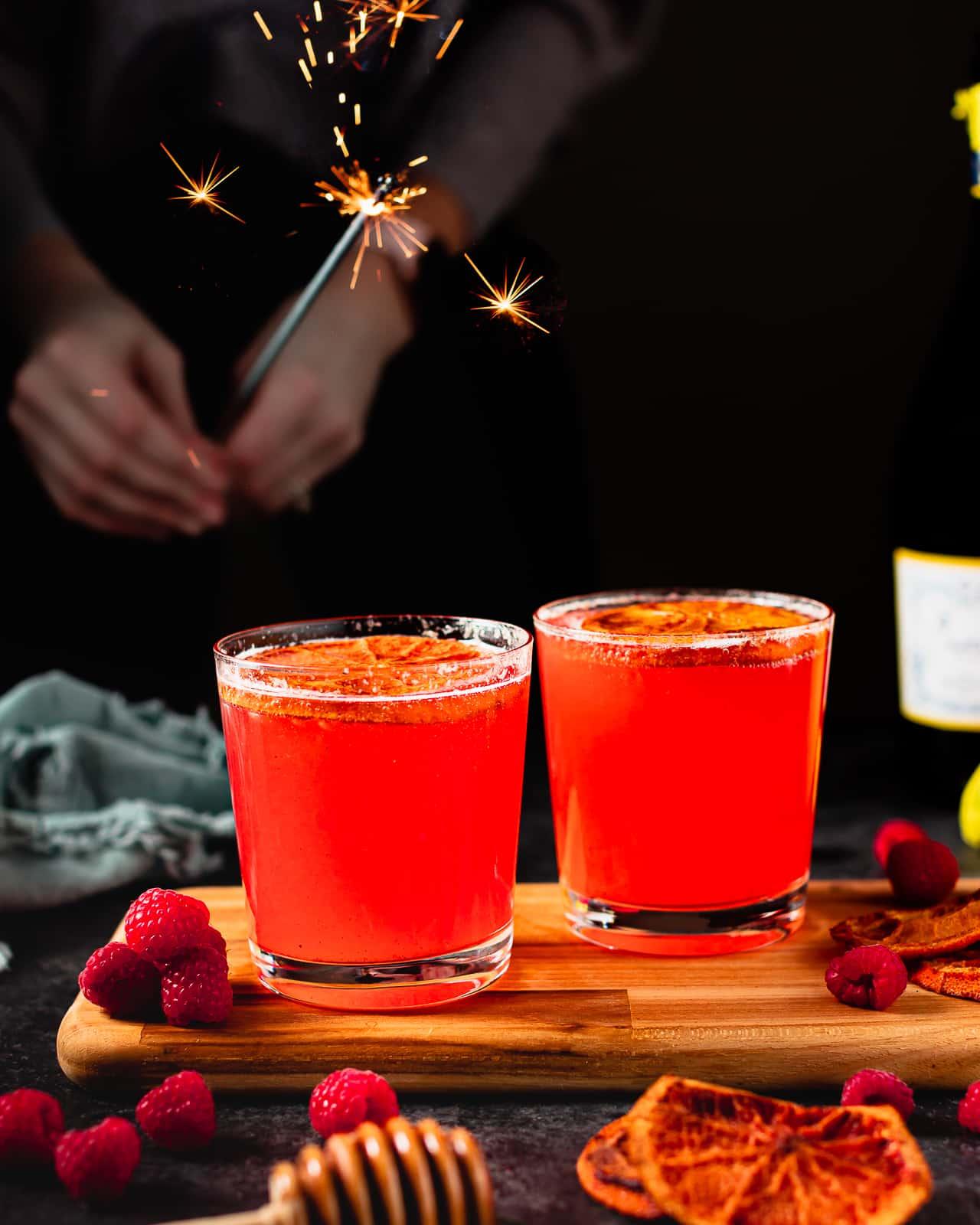 Raspberry, Orange & Honey Champagne Cocktails
