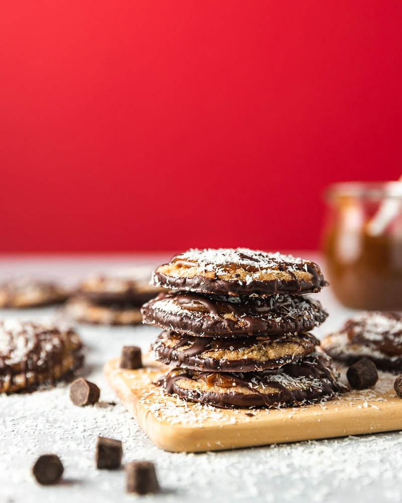 shortbread cookies with caramel, coconut flakes, and chocolate