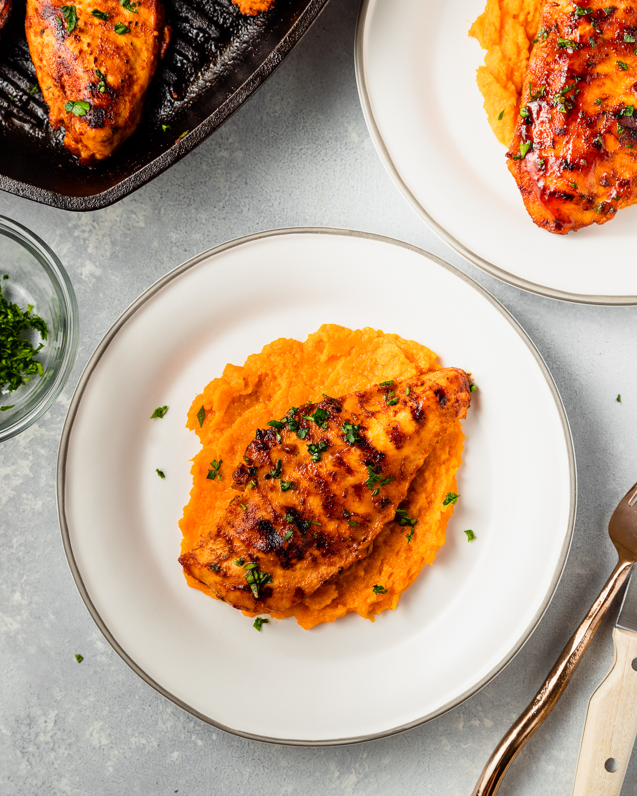 barbecue chicken served with mashed sweet potatoes