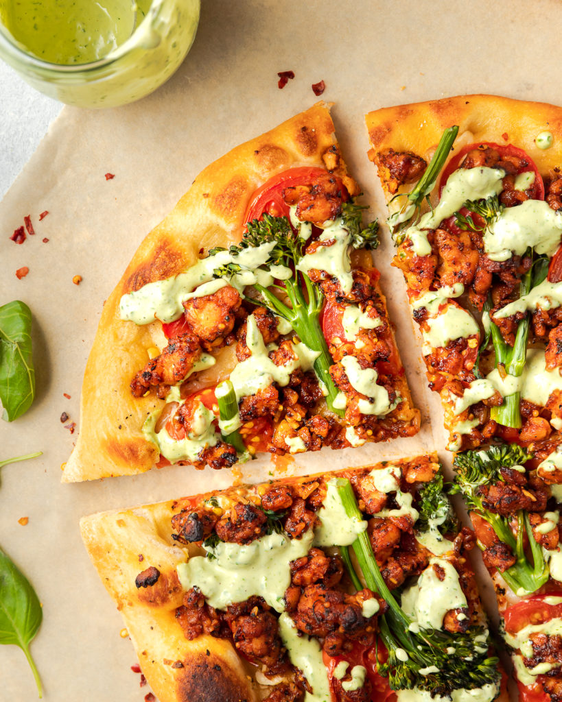 Pizza with broccolini, tempeh, tomatoes and basil sauce