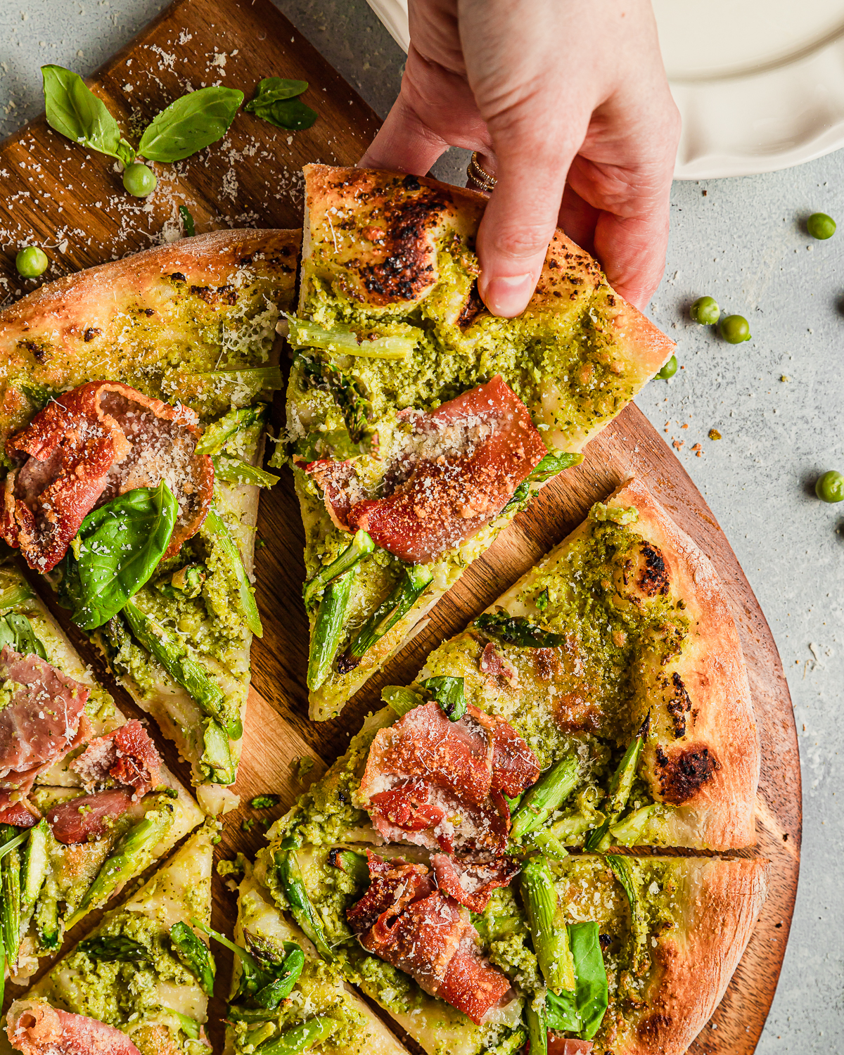 A slice of Asparagus Pizza with Prosciutto