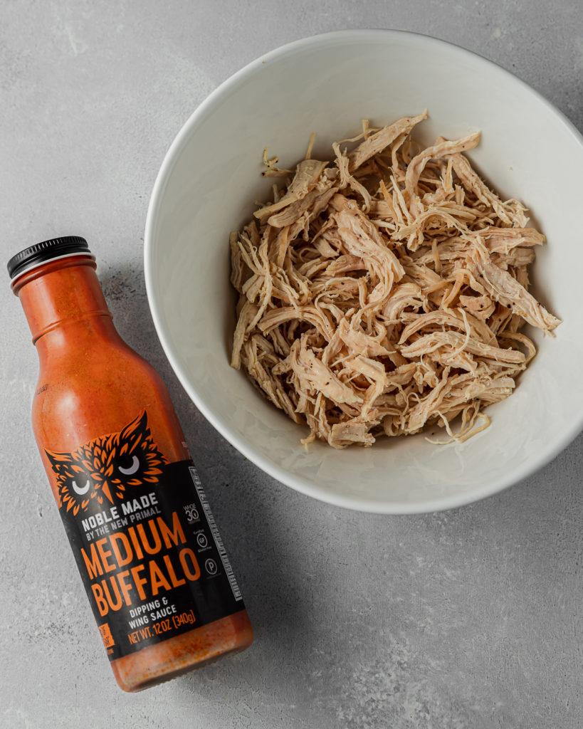 Shredded Chicken and The New Primal Medium Buffalo Sauce