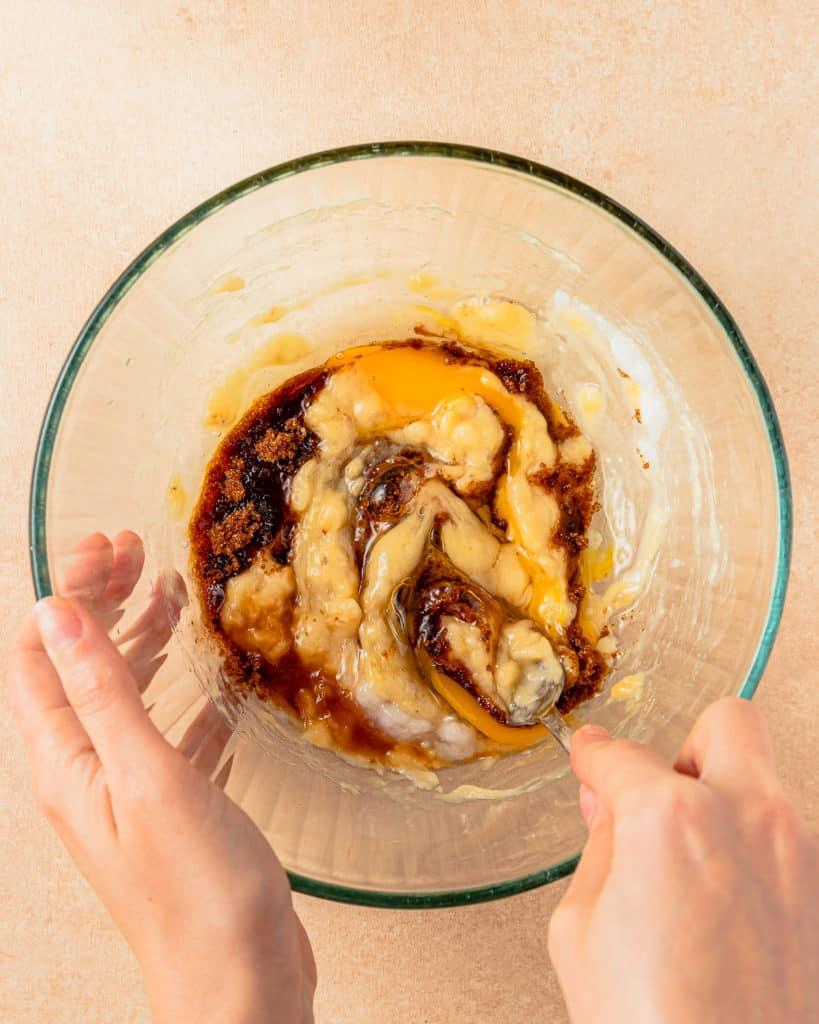 Whisking banana cookie Ingredients in bowl